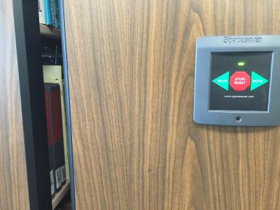 Green light on mobile shelving control panel - ready to open closed aisle